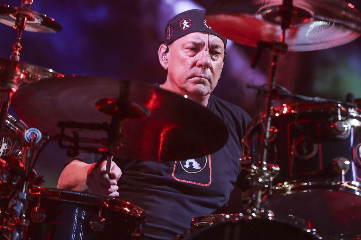FILE - This Aug. 1, 2015 file photo shows Neil Peart of Rush performing during the final show of the R40 Tour in Los Angeles. Peart, the renowned drummer and lyricist from the band Rush, has died. His rep Elliot Mintz said in a statement Friday that he died at his home Tuesday, Jan. 7, 2020 in Santa Monica, Calif. He was 67. (Photo by Rich Fury/Invision/AP, File)