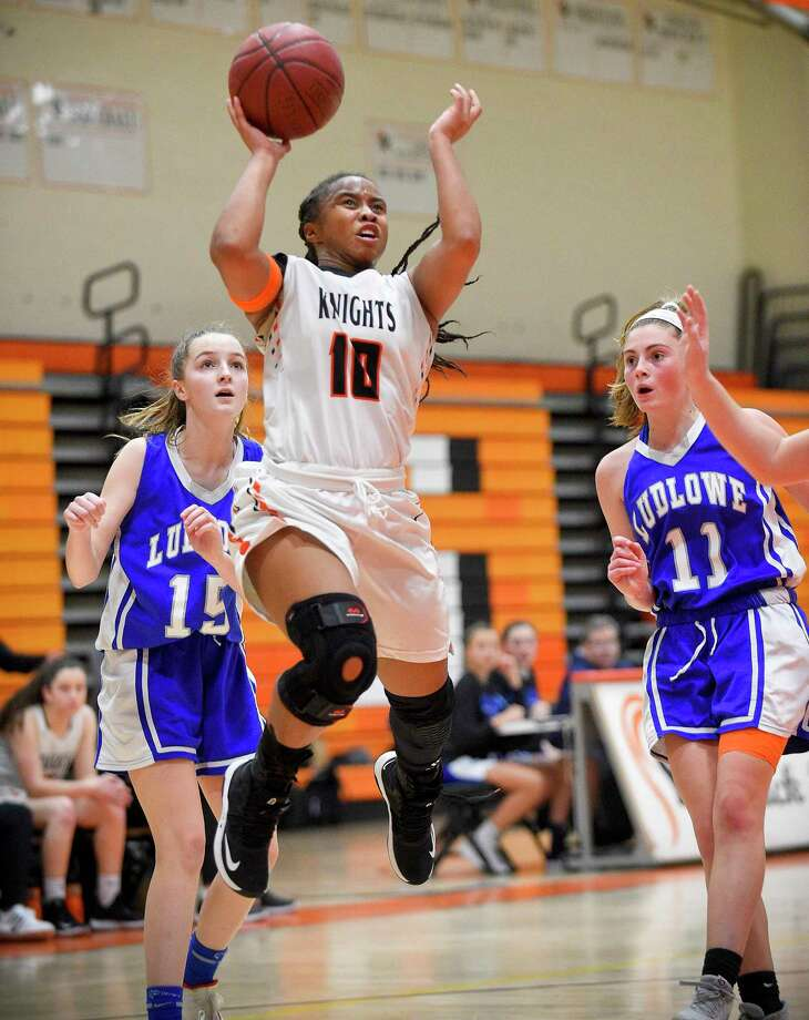 Stamford's Jessica Nelson (10) puts up a shot between Fairfield Ludlowe's Laura Herron (15) and Emma Torello (11) on Friday. Stamford defeated Ludlowe 37-32. Photo: Matthew Brown / Hearst Connecticut Media / Stamford Advocate