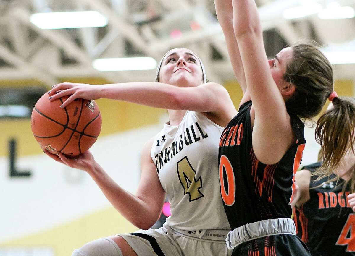 Sarah Stolze takes the ball inside during Trumbull's game with Ridgefield.