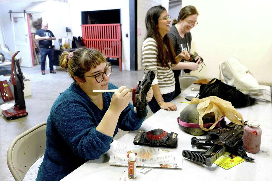 Olivia Busceme adds paint to some padding as she and others work on costumes for The Art Studio, Inc.'s upcoming annual fundraiser Beaux Arts Ball - Winter Wonder Wasteland. The January 18 event has a post-apocalyptic theme. Photo taken Thursday, January 2, 2020 Kim Brent/The Enterprise Photo: Kim Brent / The Enterprise / BEN