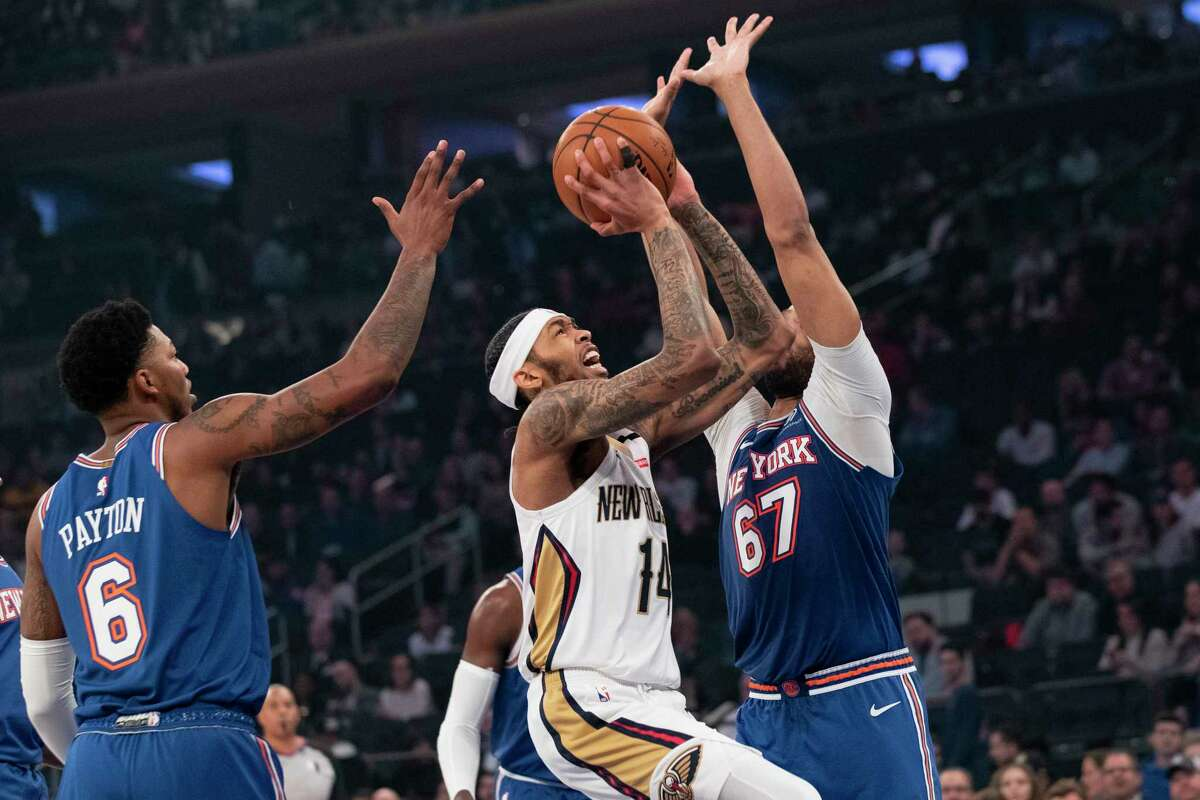 New Orleans Pelicans forward Brandon Ingram (14) goes to the basket against New York Knicks forward Taj Gibson (67) and guard Elfrid Payton (6) during the first half of an NBA basketball game, Friday, Jan. 10, 2020, at Madison Square Garden in New York. (AP Photo/Mary Altaffer)