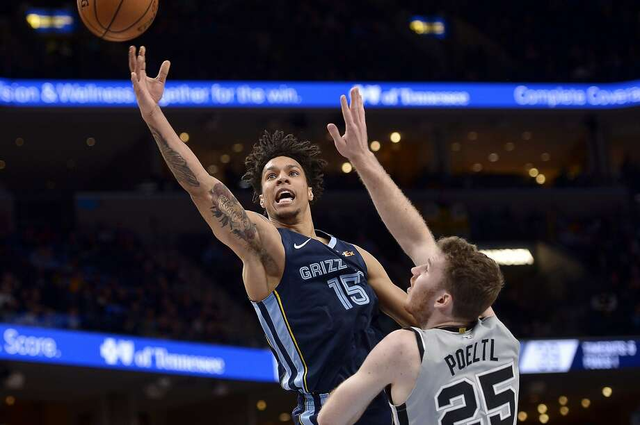 Memphis Grizzlies forward Brandon Clarke (15) shoots against San Antonio Spurs center Jakob Poeltl (25) in the first half of an NBA basketball game Friday, Jan. 10, 2020, in Memphis, Tenn. (AP Photo/Brandon Dill) Photo: Brandon Dill, Associated Press