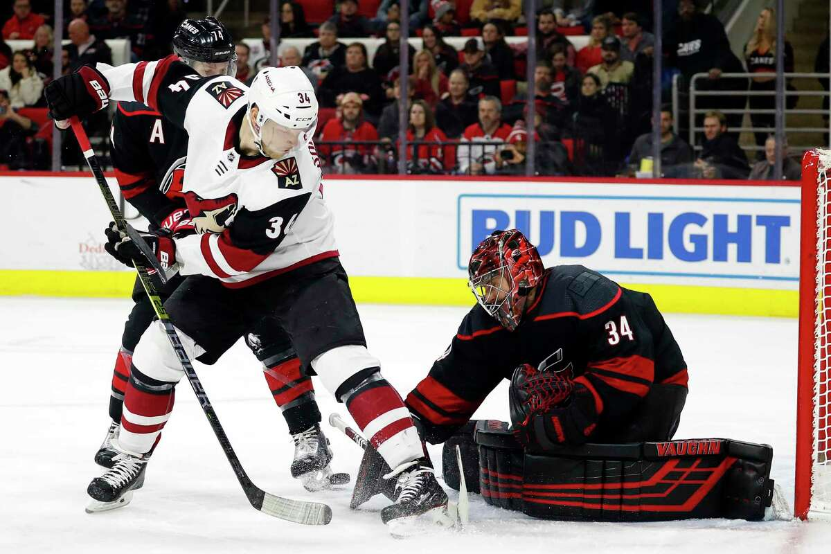 Arizona Coyotes' Carl Soderberg (34), of Sweden, loses control of the puck in front of Carolina Hurricanes goaltender Petr Mrazek (34), of the Czech Republic, during the first period of an NHL hockey game in Raleigh, N.C., Friday, Jan. 10, 2020. (AP Photo/Karl B DeBlaker)