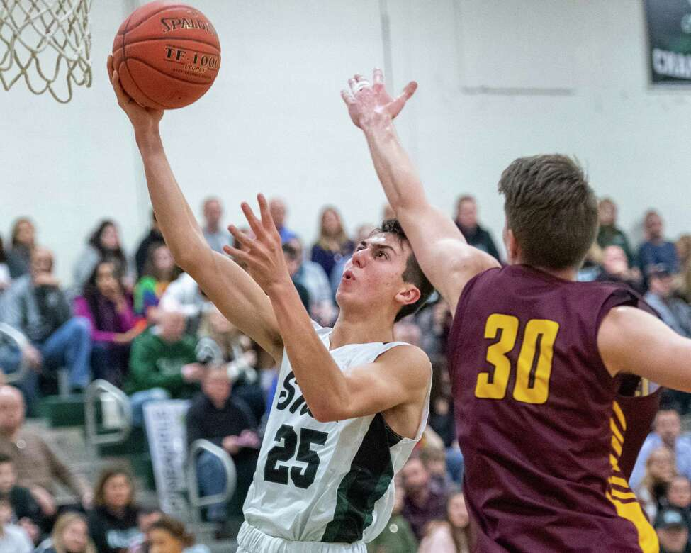 Shenendehowa junior Devin Dzikas drives to the basket in front of Colonie senior Logan Scott during a Suburban Council game at Shenendehowa High School on Friday, Jan. 10, 2019 (Jim Franco/Special to the Times Union.)