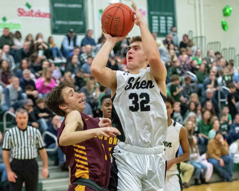 Shenendehowa senior Jake Reinisch takes a jumper over Colonie senior Dylan Antoniak during a Suburban Council game at Shenendehowa High School on Friday, Jan. 10, 2019 (Jim Franco/Special to the Times Union.)