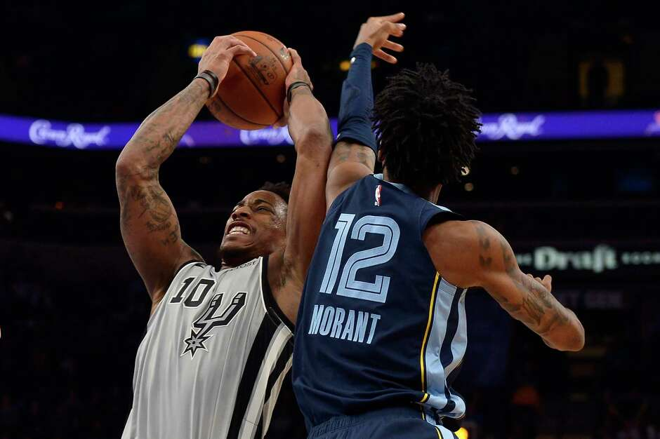 DeMar DeRozan battles Grizzlies point guard Ja Morant. DeRozan had a game-high 36 points for the Spurs, while Morant had 22 points and 14 assists.