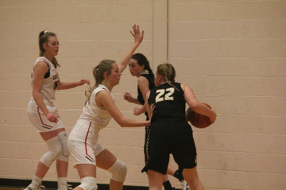 Reed City's girls basketball team won its first game of the season 61-60 over Tri County on Friday. Photo: John Raffel
