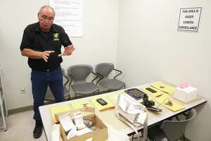 SAPD Property Room Supervisor Darrell Allen explains the processing of items as the San Antonio Police offer a look at the property room on Academic Court on Jan. 10, 2020.