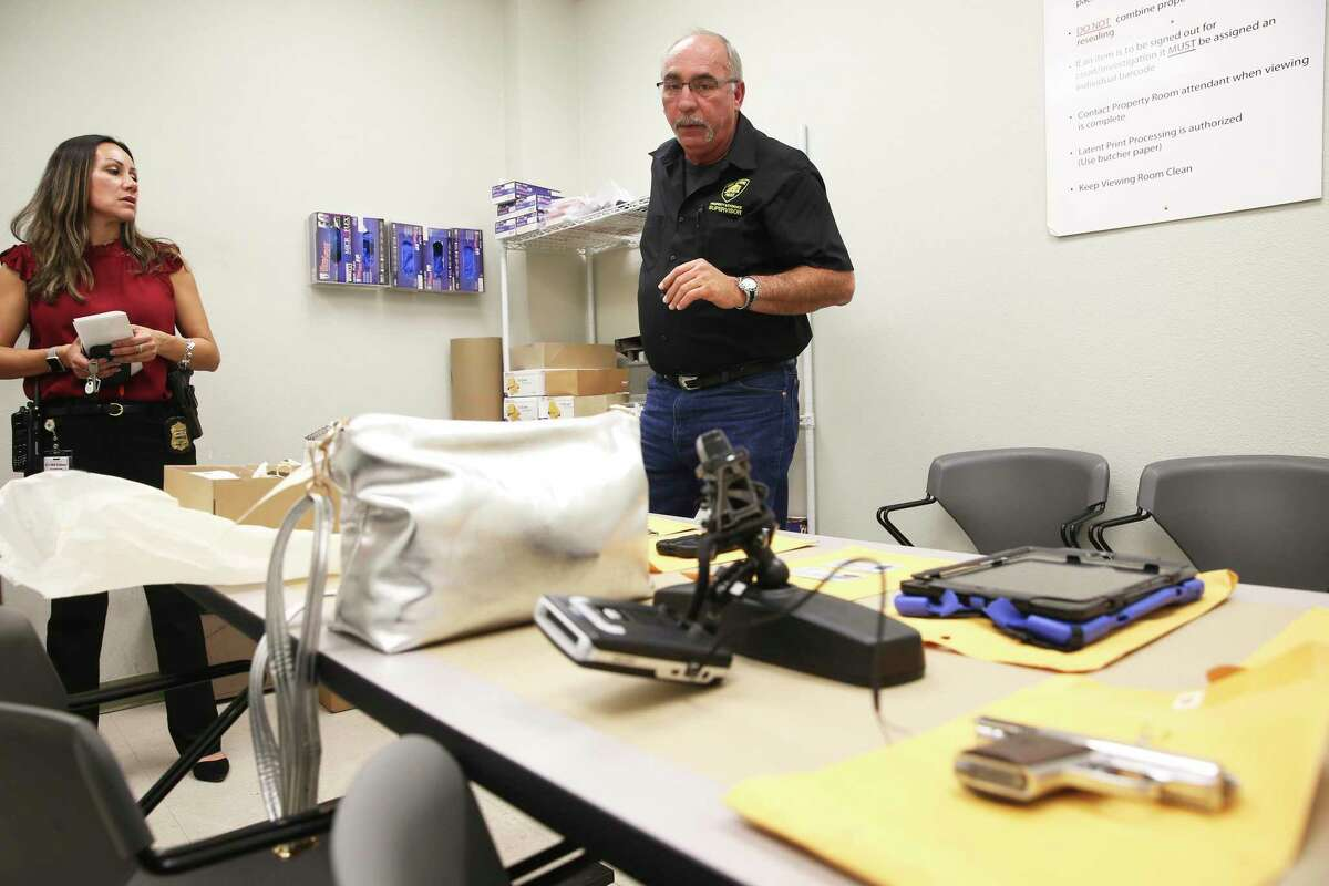SAPD Property Room Supervisor Darrell Allen explains the processing of items as the San Antonio Police offer a look at the property room on Academic Court on Jan. 10, 2020. Sgt. Michelle Ramos accompianies.