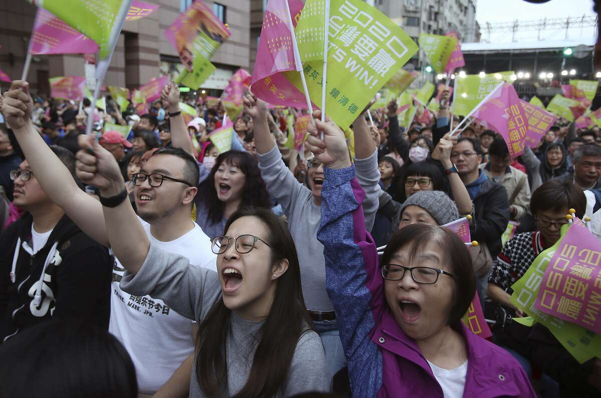 """Supporters of Taiwan's presidential election candidate, Taiwan president Tsai Ing-wen cheer for her victory as they gather to watch early election returns in Taipei, Taiwan, Saturday, Jan. 11, 2020. The banner, center, reads """"Taiwan Is An Independent Country"""". (AP Photo/Chiang Ying-ying)"""