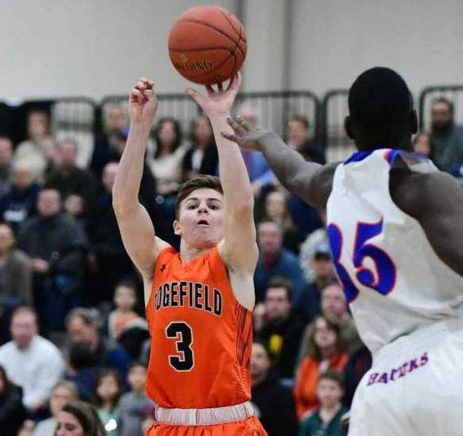 Johnny Briody (shown in last year's FCIAC championship game) was one of three seniors who combined for 51 points as Ridgefield beat Trumbull on Friday night. Photo: Erik Trautmann / Hearst Connecticut Media
