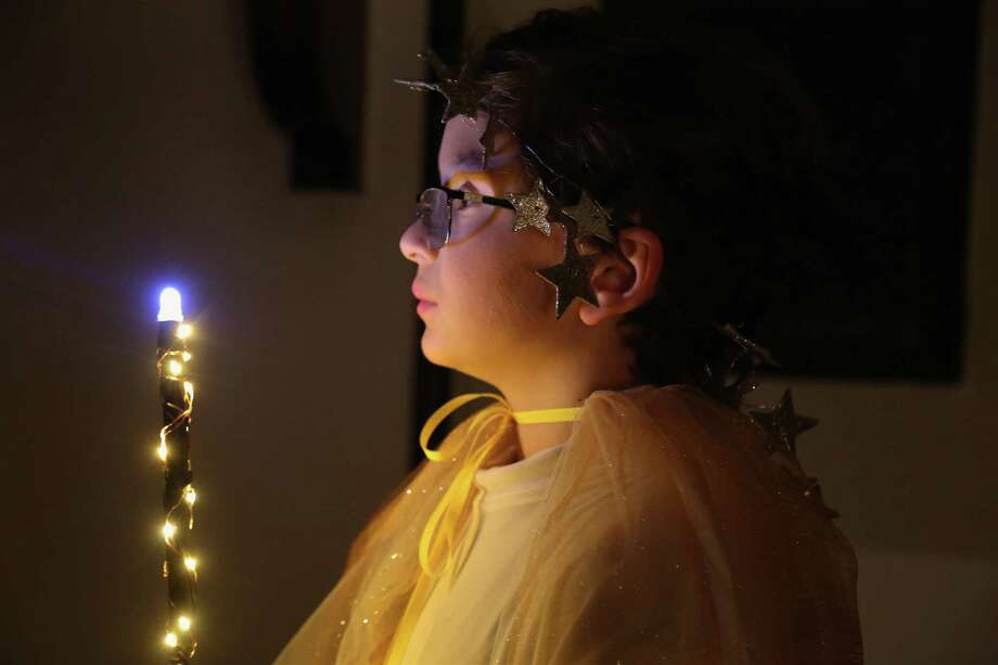 Ashton Deutsch, 10, of Fairfield, the bearer of light, begins The Boar's Head festival at St. Paul's Episcopal Church on Friday, Jan. 10, 2020, in Fairfield, Conn. Photo: Jarret Liotta / Jarret Liotta / ©Jarret Liotta