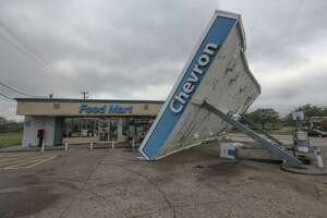Strong winds overnight toppled the canopy covering the gas pumps of a Chevron station at 3655 W. Orem Drive Saturday, Jan. 11, 2020, in Houston.