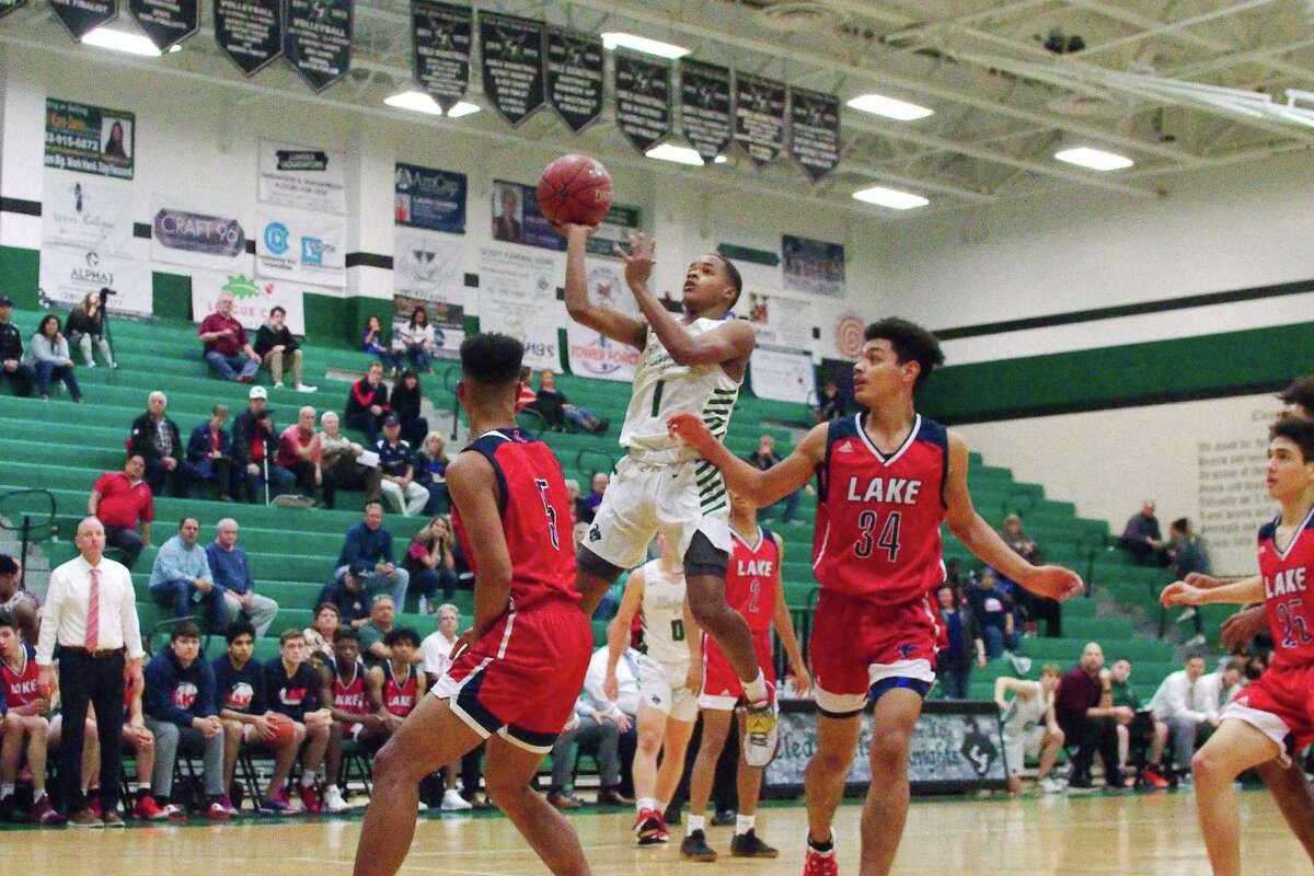 Clear Falls' Orlando Horton Jr. (1) puts up a shot against Clear Lake Friday at Clear Falls High School.