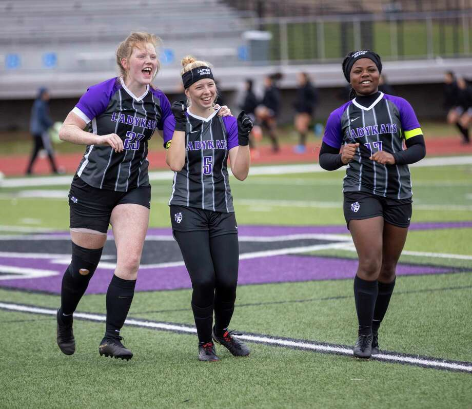 Willis defenders Emma Holliday (23), Liv Fields (5) and Briance Lang (17) celebrate after a win against Spring at the Kat Cup on Saturday. Photo: Gustavo Huerta, Houston Chronicle / Staff Photographer / Houston Chronicle