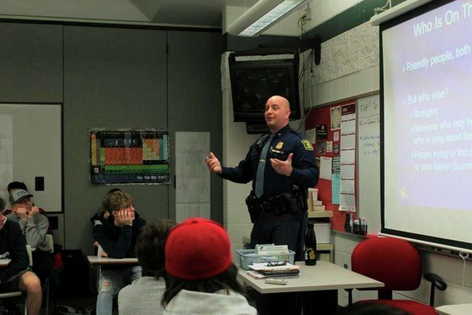 A Michigan State Police Officer talked with BRHS students about various ways to stay safe while using social media. This was part of students online safety training. (Pioneer photo/Catherine Sweeney)