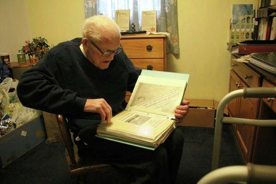 """Leonard """"Pic"""" DeFrain shows off years of collected history. (Sara Eisinger/ Huron Daily Tribune)"""