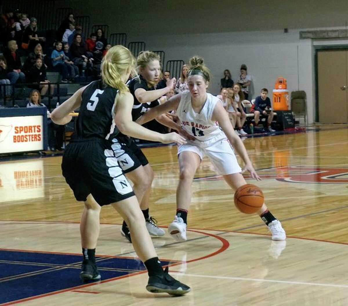 Rylie Haist of Big Rapids dribbles into the Newaygo defense during BR's 45-39 home win on Friday night. (Pioneer photo/Joe Judd)