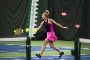 Angie Allen of Bay City returns the ball while competing in the World Team Tennis Tournament Saturday, Jan. 11, 2020 at the Greater Midland Tennis Center. (Katy Kildee/kkildee@mdn.net)