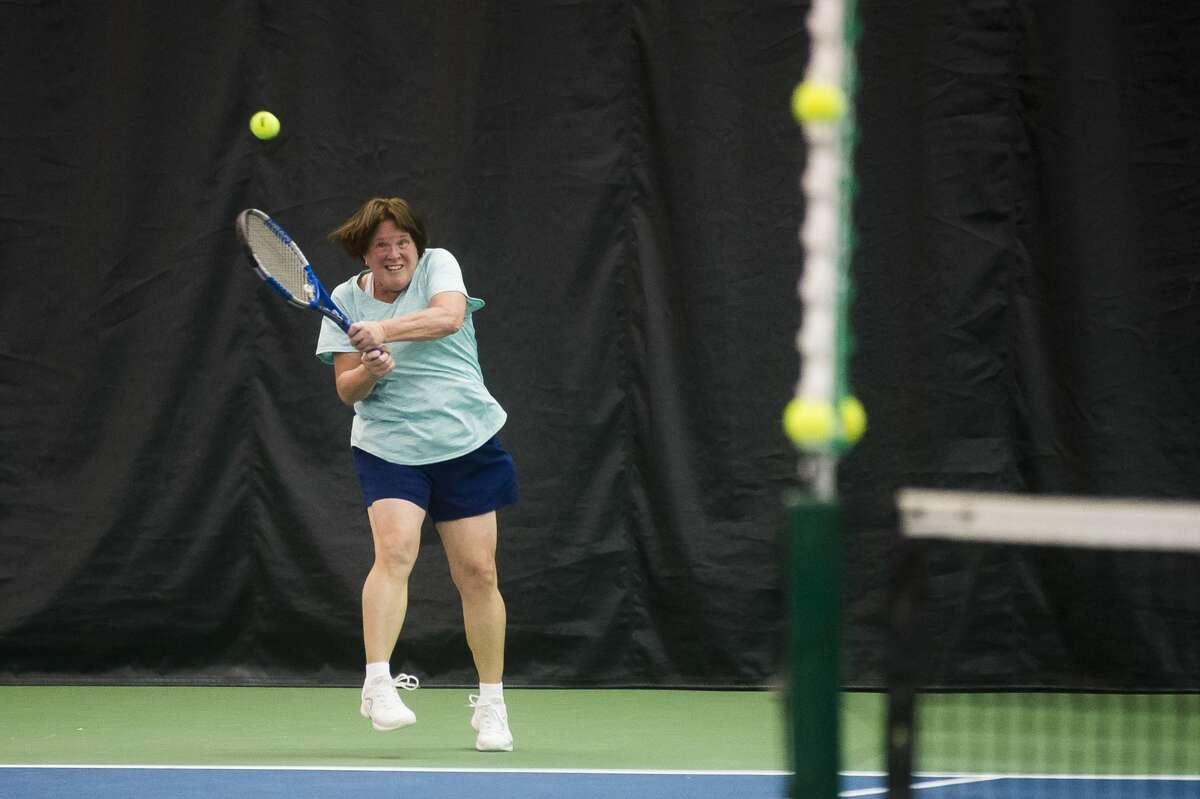 Jayne Carson of Bay City returns the ball while competing in the World Team Tennis Tournament Saturday, Jan. 11, 2020 at the Greater Midland Tennis Center. (Katy Kildee/kkildee@mdn.net)