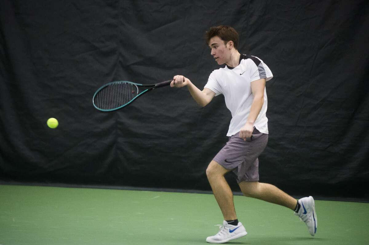 Connor Bash of Bay City returns the ball while practicing with a friend during the World Team Tennis Tournament Saturday, Jan. 11, 2020 at the Greater Midland Tennis Center. (Katy Kildee/kkildee@mdn.net)