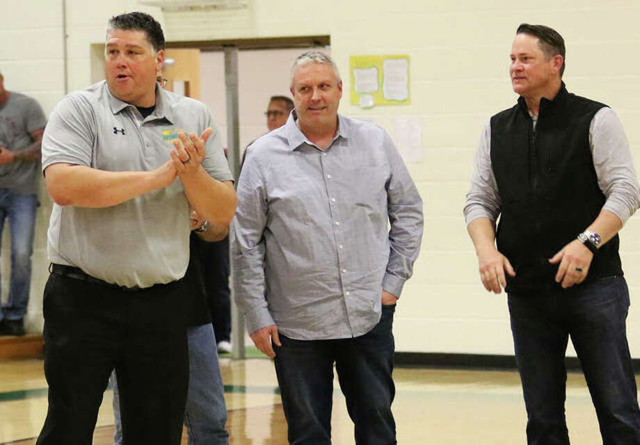 Former Piasa Birds (from left) Shaun Watson, Matt Buhs and Jason Isringhausen stand at midcourt Friday night during a halftime ceremony honoring Southwestern's 1990 baseball team that finished fourth at the Class A state tournament in Springfield. All three — Watson and Izzy by the Mets and Buhs by the Rangers — were MLB draft picks and professional pitchers. Photo: Greg Shashack / The Telegraph