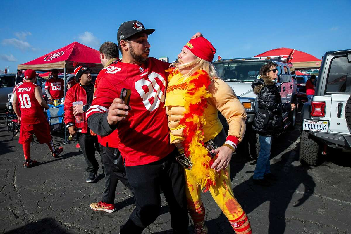 From left: Gurchet Sanghera and Nicole Manasewitsch chest bump each other at a tailgate before an NFC Divisional Round playoff game between the San Francisco 49ers and Minnesota Vikings on Saturday, Jan. 11, 2020, in Santa Clara, Calif.