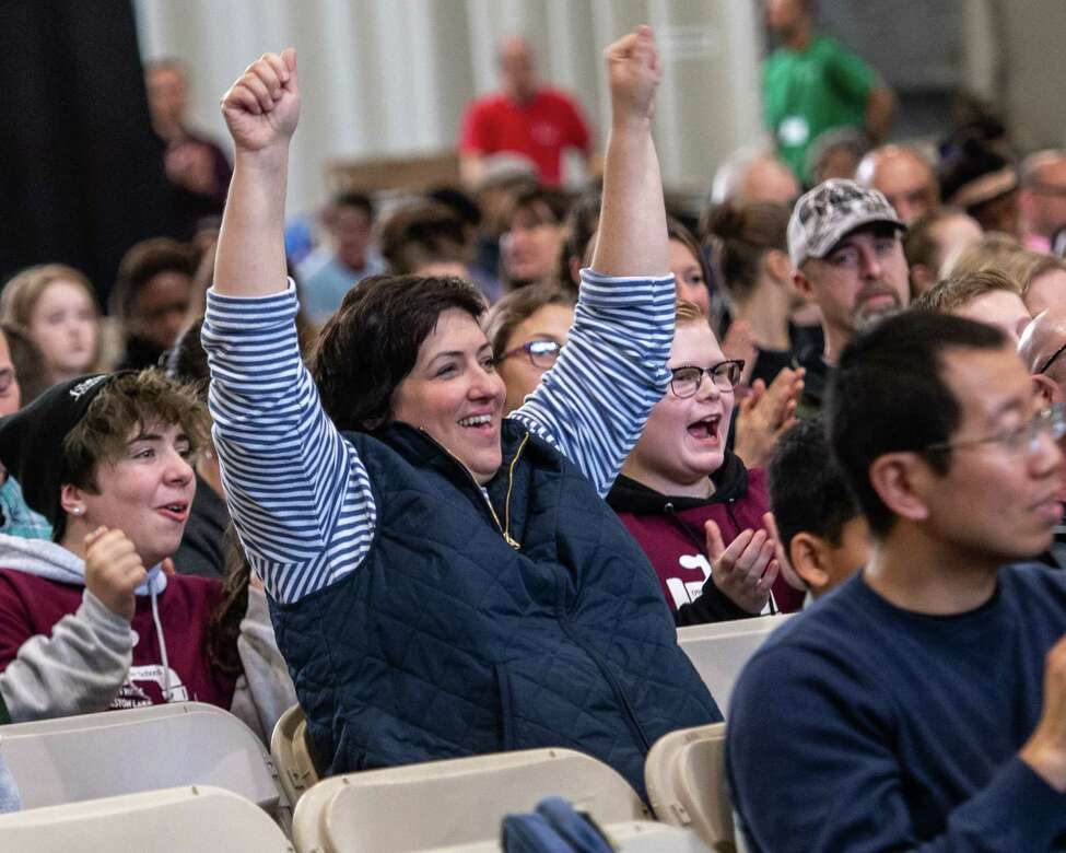 Amy Mizaga, of Ballston Spa, cheers for the team from the Richard O'Rourke Middle School in Burnt Hills during the annual National Engineers Week Future City Competition held at the Sage College Armory on Saturday, Jan. 11, 2019 (Jim Franco/Special to the Times Union.)
