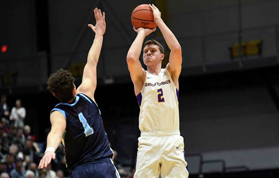 Maine guard Mykhailo Yagodin (1) defends against University at Albany guard Malachi De Sousa (1) during the first half of an NCAA basketball game Saturday Jan. 11, 2020, in Albany, N.Y.