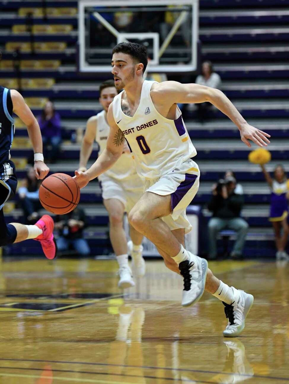 University at Albany guard Antonio Rizzuto (0) moves the ball against Maine during the first half of an NCAA basketball game Saturday Jan. 11, 2020, in Albany, N.Y.