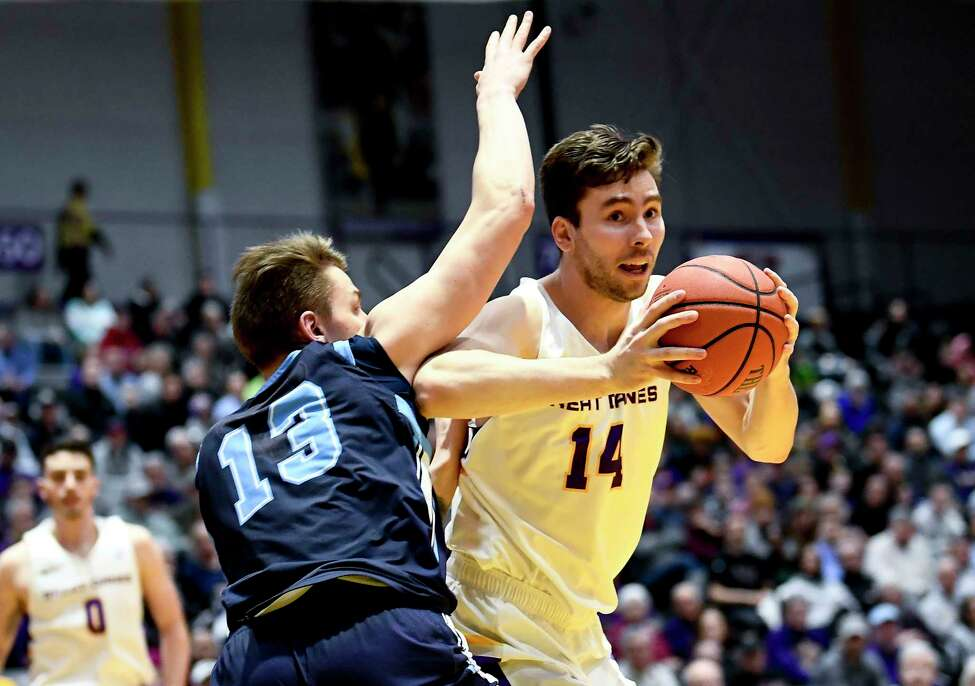 Maine forward Miks Antoms (13) defends against University at Albany forward Adam Lulka (14) during the first half of an NCAA basketball game Saturday Jan. 11, 2020, in Albany, N.Y.