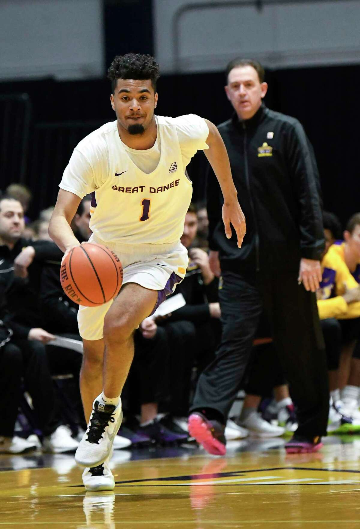 University at Albany guard Malachi De Sousa (1) moves the ball against Maine during the first half of an NCAA basketball game Saturday Jan. 11, 2020, in Albany, N.Y.