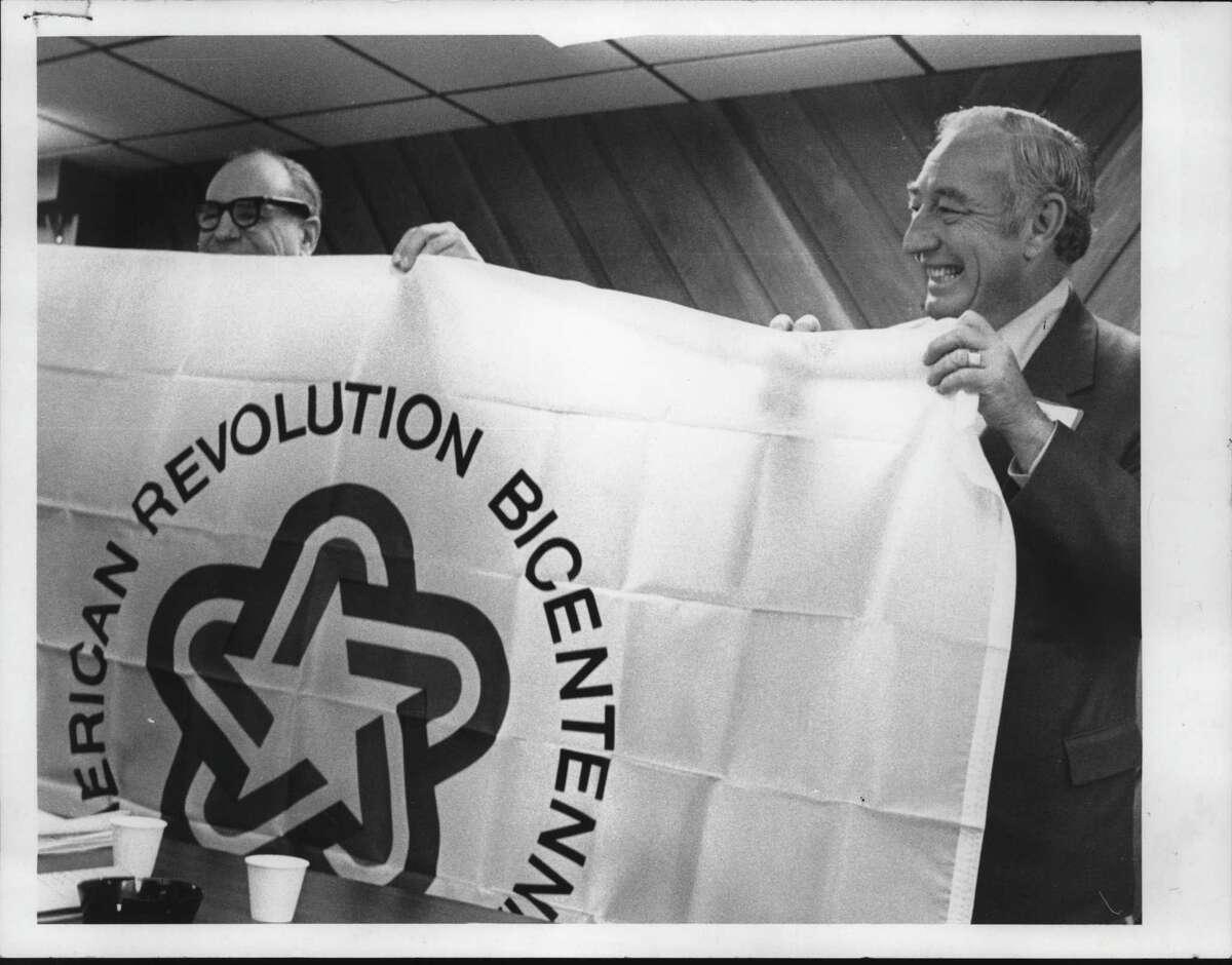 Clifton Park, New York officials unveil bicentennial flag - Richard Allen with John Van de Car. January 12, 1976 (Times Union Archive)