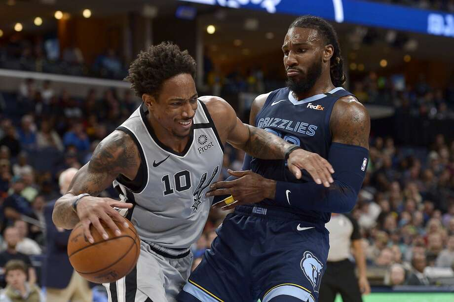 San Antonio Spurs guard DeMar DeRozan (10) handles the ball against Memphis Grizzlies forward Jae Crowder in the second half of an NBA basketball game Friday, Jan. 10, 2020, in Memphis, Tenn. (AP Photo/Brandon Dill) Photo: Brandon Dill, Associated Press