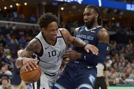 San Antonio Spurs guard DeMar DeRozan (10) handles the ball against Memphis Grizzlies forward Jae Crowder in the second half of an NBA basketball game Friday, Jan. 10, 2020, in Memphis, Tenn. (AP Photo/Brandon Dill)