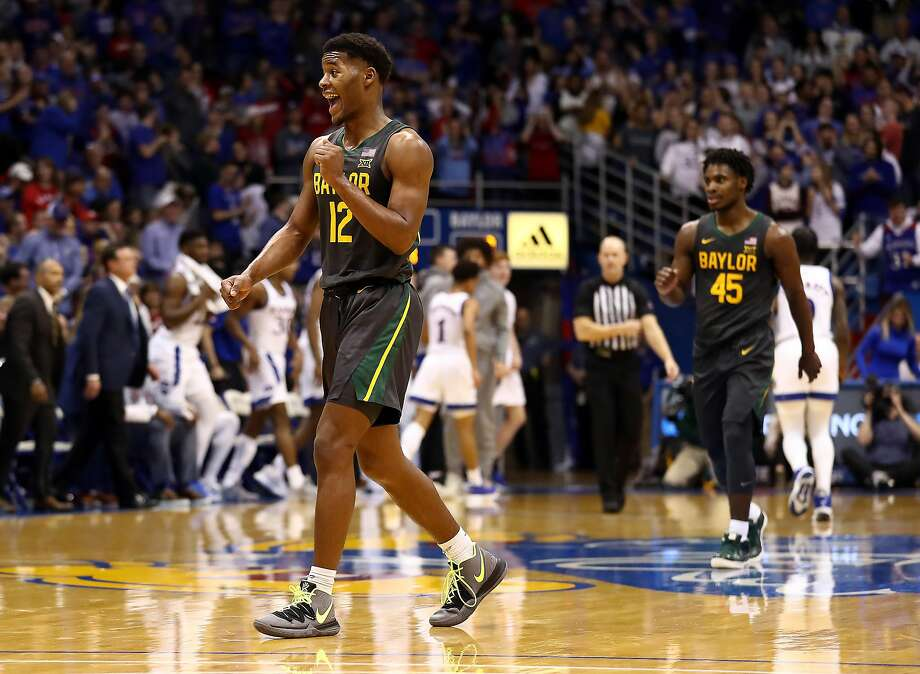 Baylor's Jared Butler, who had 22 points, appears to be enjoying his afternoon at Allen Fieldhouse. Photo: Jamie Squire / Getty Images