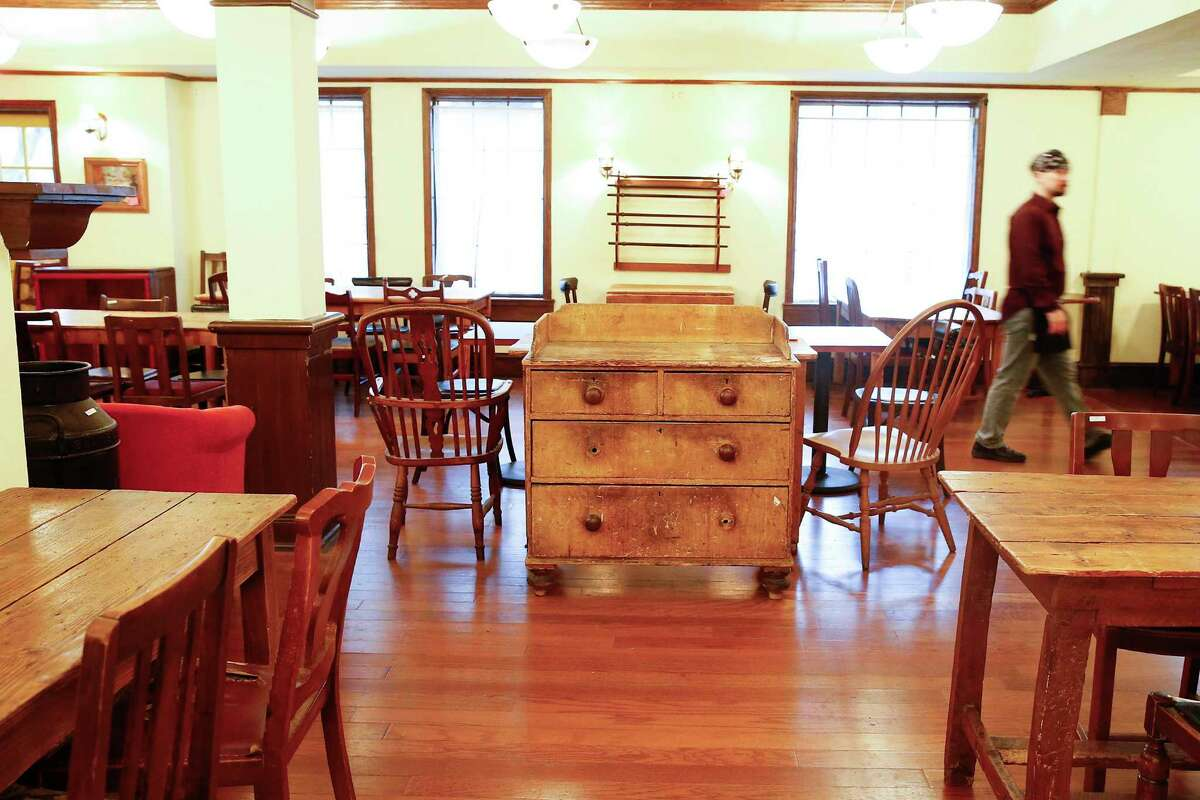 A variety of wood furniture is included in the estate sale at The Black Labrador, a long-time English pub mainstay in the Montrose neighborhood on Friday, Jan. 10, 2020 in Houston.