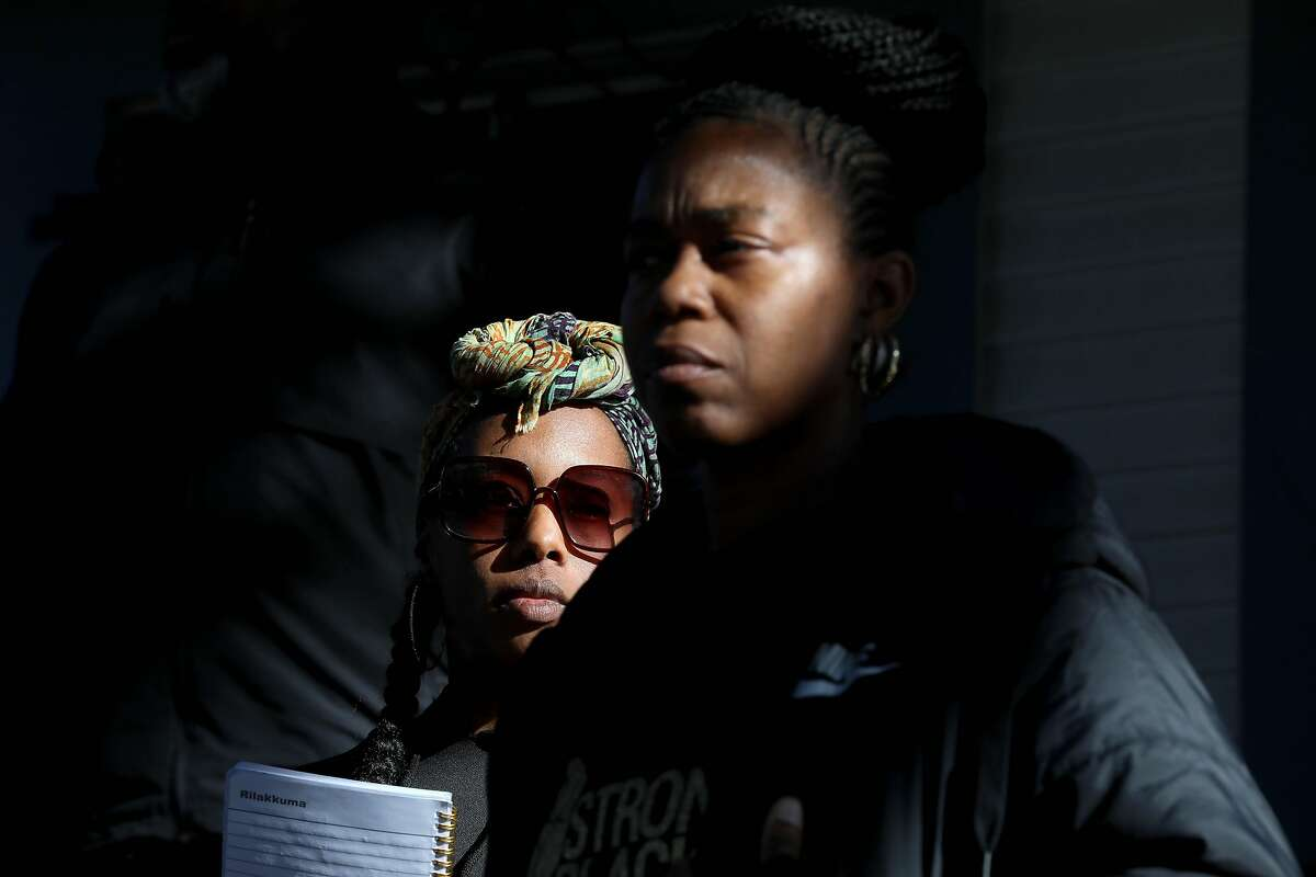 (From left to right) Dominique Walker and Tolani King attend a press conference at the Magnolia Street home they've been occupying since November 2019, in Oakland, Calif., on Friday, January 10, 2020. A judge ruled Friday that a group of homeless mothers don't have a legal right to the property.