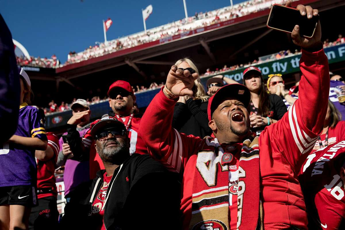 A 49ers fan cheers in the stands during a NFC Divisional Playoff game between the San Francisco 49ers and Minnesota Vikings held at Levis Stadium in Santa Clara, Calif. Saturday, Jan. 11, 2020.