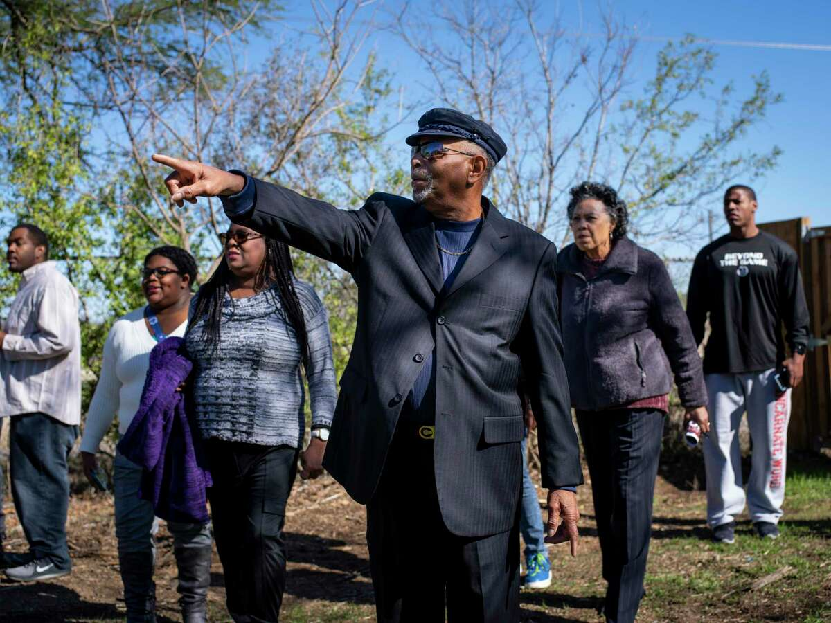 Velmil Clay, 76, center, whose father and three brothers are buried at the historic and long forgotten African American Hockley-Clay cemetery, describes the way his grandmother used to select plots for burial to fellow descendants of relatives buried at the cemetery in San Antonio, Texas, on Thursday, January 11, 2020. The Hockley-Clay Cemetery is a long forgotten African American graveyard from the late 1800s, located on the Northeast Side. Descendants of relatives buried at the cemetery visited the site on Saturday following a panel discussion on the progress being made to improve the cemetery grounds.