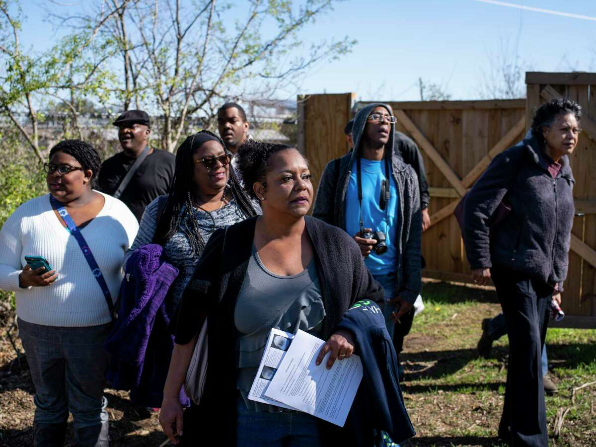 Toni Satterwhite, 47, center, and other descendants of relatives buried at the historic African American Hockley-Clay Cemetery in San Antonio, Texas, see the site for the first time after it has been cleared of excess brush on Thursday, January 11, 2020. The Hockley-Clay Cemetery is a long forgotten African American graveyard from the late 1800s, located on the Northeast Side. Descendants of relatives buried at the cemetery visited the site on Saturday following a panel discussion on the progress being made to improve the cemetery grounds.