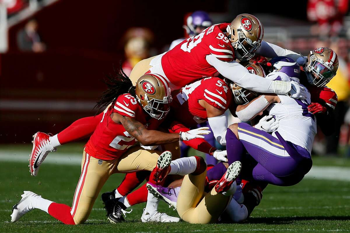 Minnesota Vikings tight end Irv Smith (84) is tackled by the San Francisco 49ers defense in the first half of an NFC Divisional Round playoff game at Levi's Stadium on Saturday, Jan. 11, 2020, in Santa Clara, Calif.