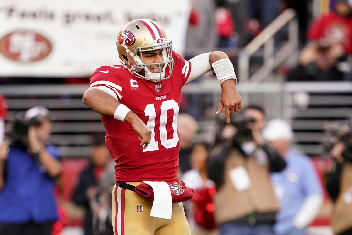 Jimmy Garoppolo #10 of the San Francisco 49ers reacts after a touchdown against the Minnesota Vikings in the third quarter of the NFC Divisional Round Playoff game at Levi's Stadium on January 11, 2020 in Santa Clara, California.