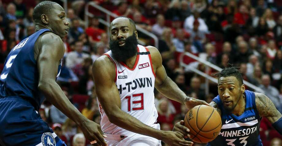 Minnesota Timberwolves forward Robert Covington (33) steals the ball away from Houston Rockets guard James Harden (13) during the first half of an NBA game at the Toyota Center Saturday, Jan. 11, 2020, in Houston. Photo: Godofredo A Vásquez/Staff Photographer