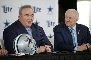 New Dallas Cowboys head coach Mike McCarthy, left, is introduced by team owner Jerry Jones, right, during a press conference at the Dallas Cowboys headquarters Wednesday, Jan. 8, 2020, in Frisco. (AP Photo/Brandon Wade)