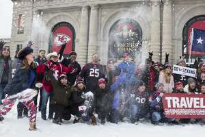 Houston Texans fan Krista Murray tosses snow as she gathers for a group photo outside Kansas City's Union Station on Saturday, Jan. 11, 2020, in Kansas City. The Texans face the Kansas City Chiefs in the AFC divisional round of the NFL playoffs on Sunday at Arrowhead Stadium.