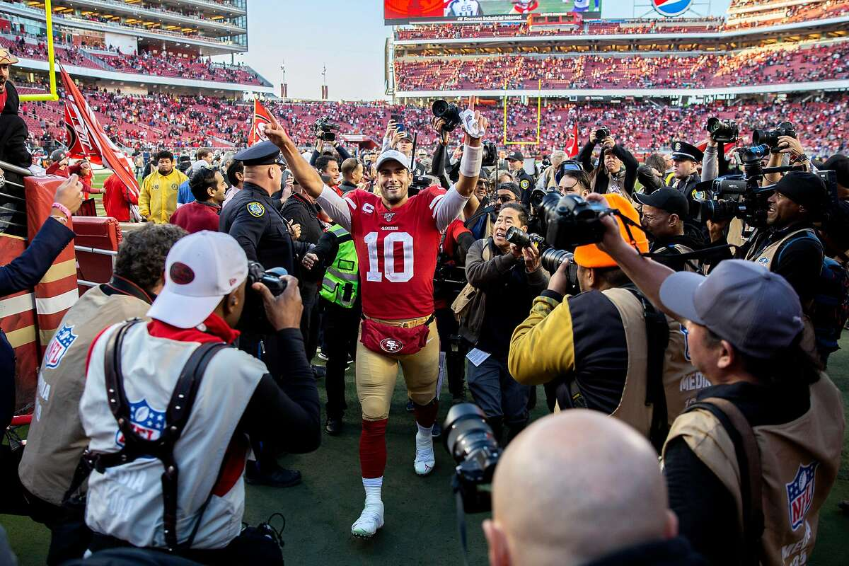 San Francisco 49ers quarterback Jimmy Garoppolo (10) acknowledges the fans as he exits the field to the locker room following the NFC Divisional Round playoff game against the Minnesota Vikings at Levi's Stadium on Saturday, Jan. 11, 2020, in Santa Clara, Calif. The 49ers won 27-10.
