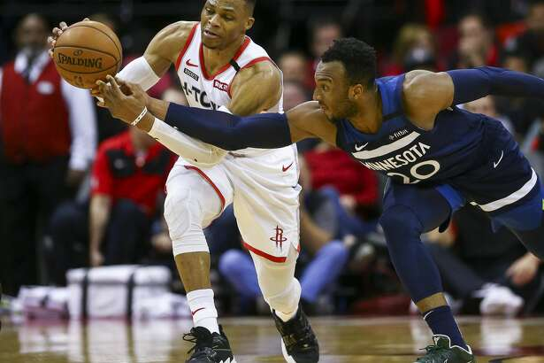 Houston Rockets guard Russell Westbrook (0) keeps possession of the ball after Minnesota Timberwolves guard Josh Okogie (20) attempted a steal during the second half of an NBA game at the Toyota Center Saturday, Jan. 11, 2020, in Houston. The Rockets won 139-109.