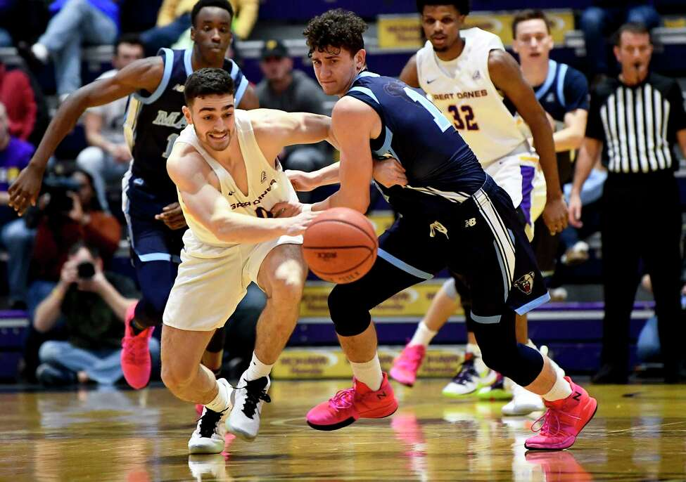 University at Albany guard Antonio Rizzuto (0)steals the ball from Maine guard Mykhailo Yagodin (1)during the first half of an NCAA basketball game Saturday Jan. 11, 2020, in Albany, N.Y. (Hans Pennink / Special to the Times Union)