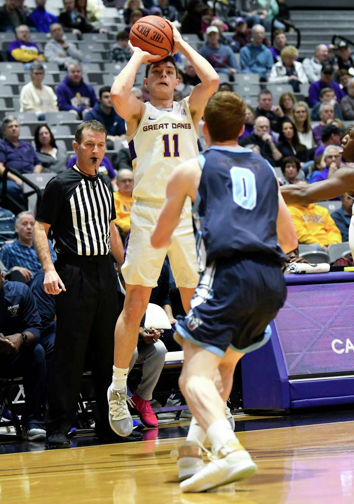 University at Albany guard Cameron Healy (11) scores against Maine forward Andrew Fleming (0) during the first half of an NCAA basketball game Saturday Jan. 11, 2020, in Albany, N.Y. (Hans Pennink / Special to the Times Union)
